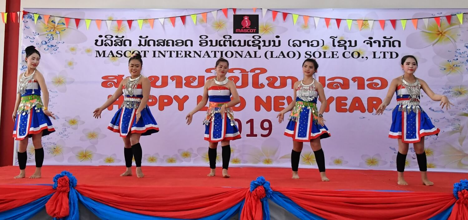 Good, safe and secure working conditions in production - New Years Laos - dancing - 2019